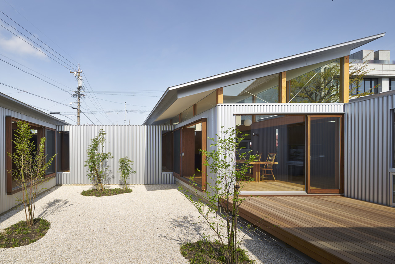 house with gardens and roofs arii irie architects